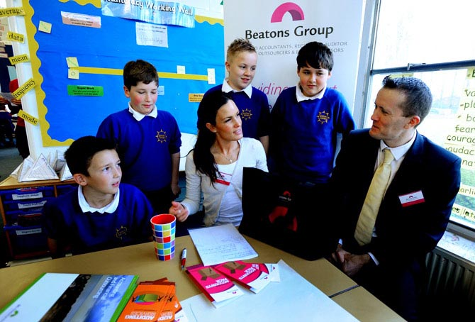 Pupils at Sprites Primary School in Ipswich as part of a visit by local firms to highlight the importance of maths in business.